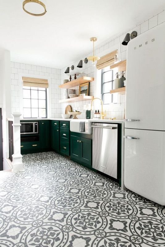 the kitchen is made more eye-catching with black and white patterned tiles on the floor