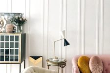 11 molding on the walls adds instant chic to the living room and some pastel touches make it look softer