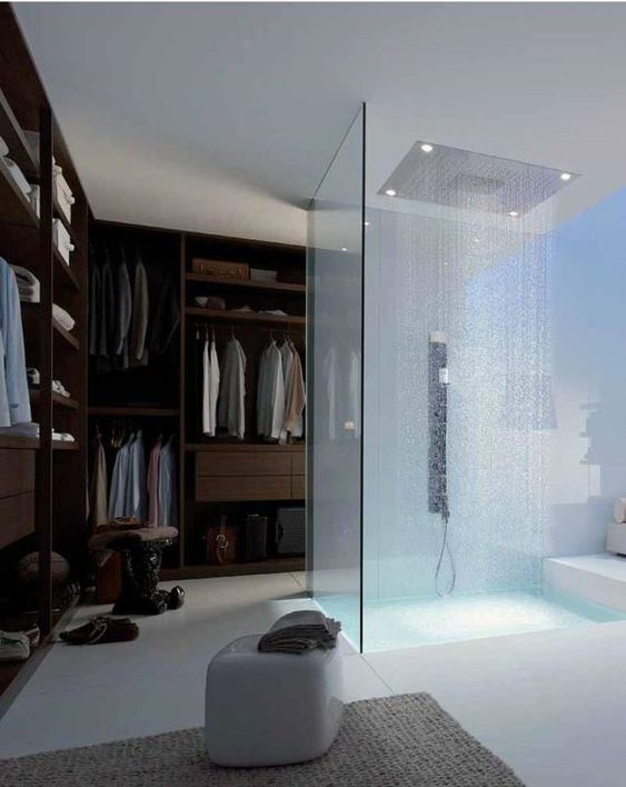 a glass enclosed shower right in the closet not to make this small space ven smaller