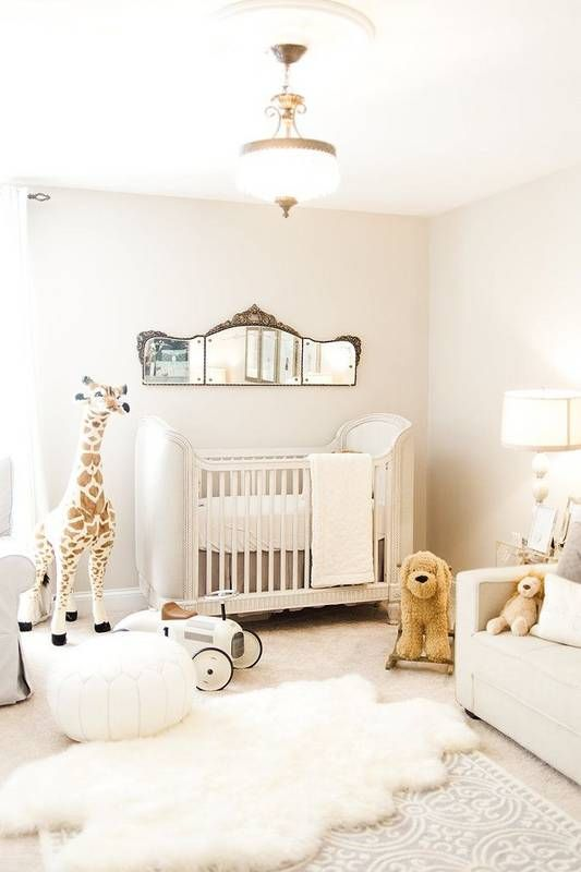 a very cozy and fluffy gender neutral nursery done in neutral shades and with neutral toys