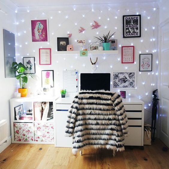 a whole wall covered with string lights makes the workspace glam, personalized and enlightened, no lamps needed