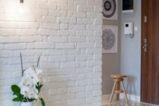 12 make the entryway more interesting with exposed white brick walls
