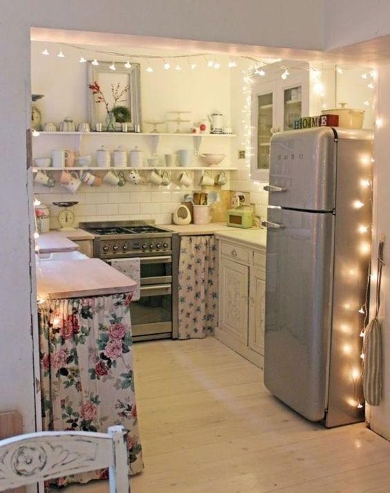 the kitchen entrance covered with string lights to accent it