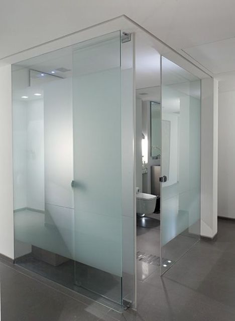 a glass cube bathroom done with blue frosted glass to make it more private and comfortable