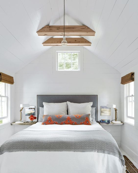 a modern farmhouse bedroom with negative space that makes it feel larger