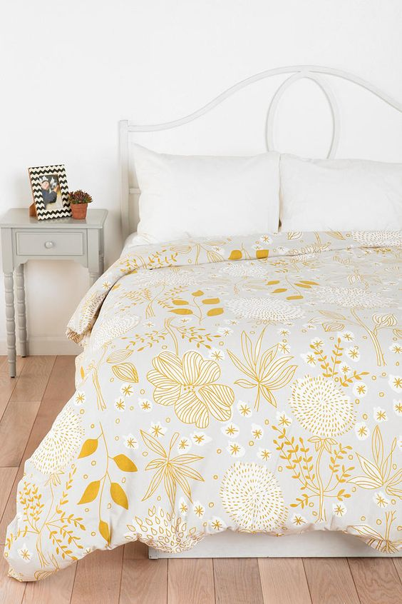 a pretty yellow floral and botanical print blanket is all you need to refresh the space for spring