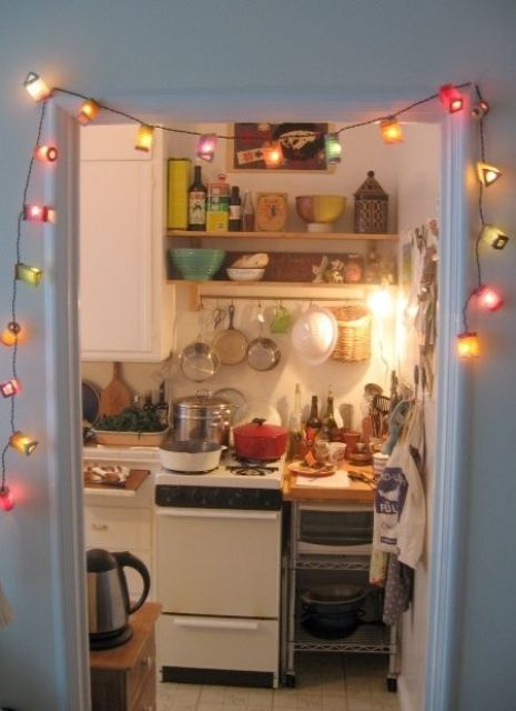 colorful vintage stirng lights that frame the kitchen entrance invite to mae in and make a cup of tea