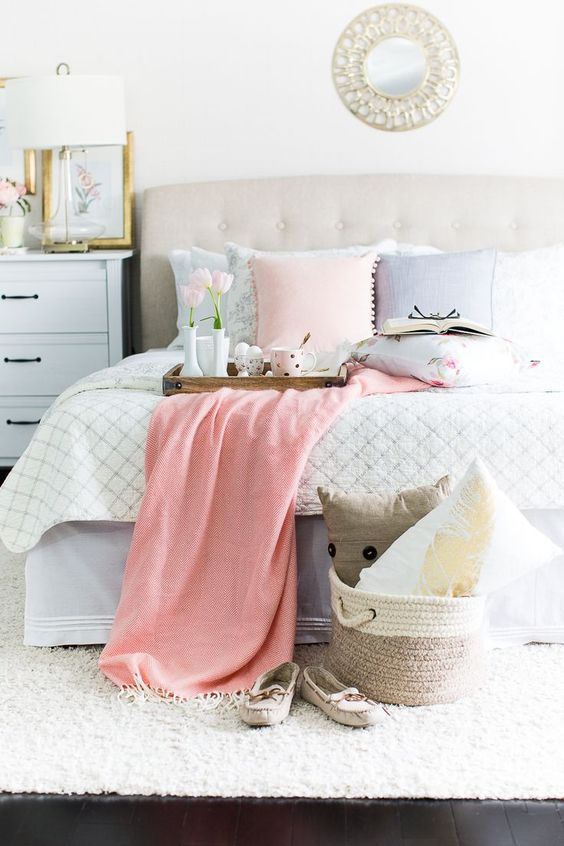 go for some pastel-colored pillows to make your bed feel spring-like