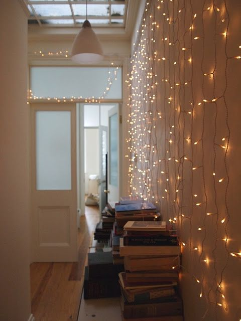 string lights on the wall will make the entryway more welcoming