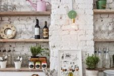 the kitchen is done with rough exposed white brick walls that make it eye-catchy