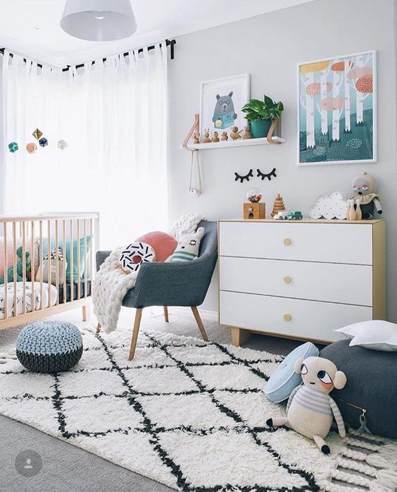 a gender neutral nursery filled with toys and with bright touches of colors