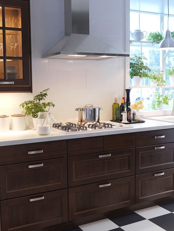 dark kitchen cabinets and large-scale white tiles for a contrast