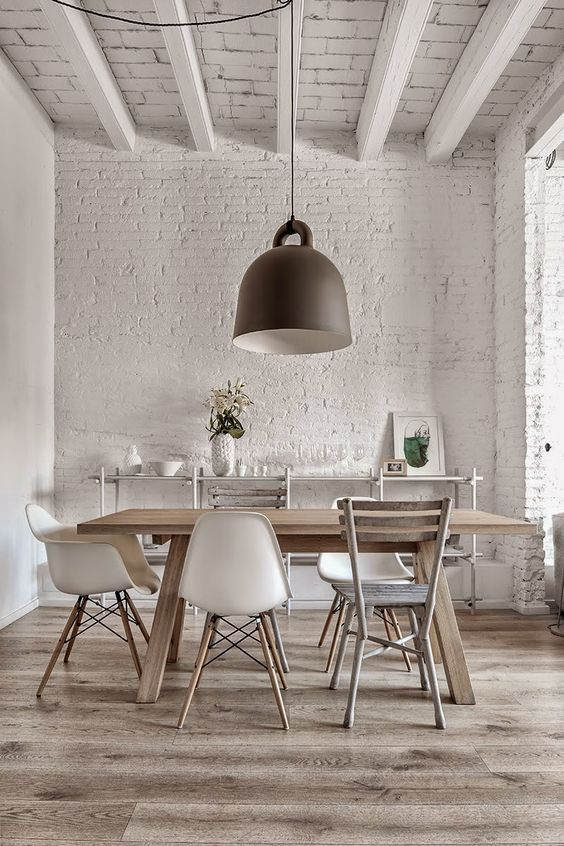 get more interest using exposed white brick walls and exposed wooden beams in your space