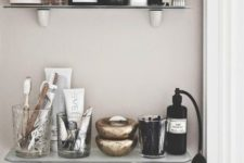 15 small open bathroom shelves of glass are a very elegant choice besides they won't take much space