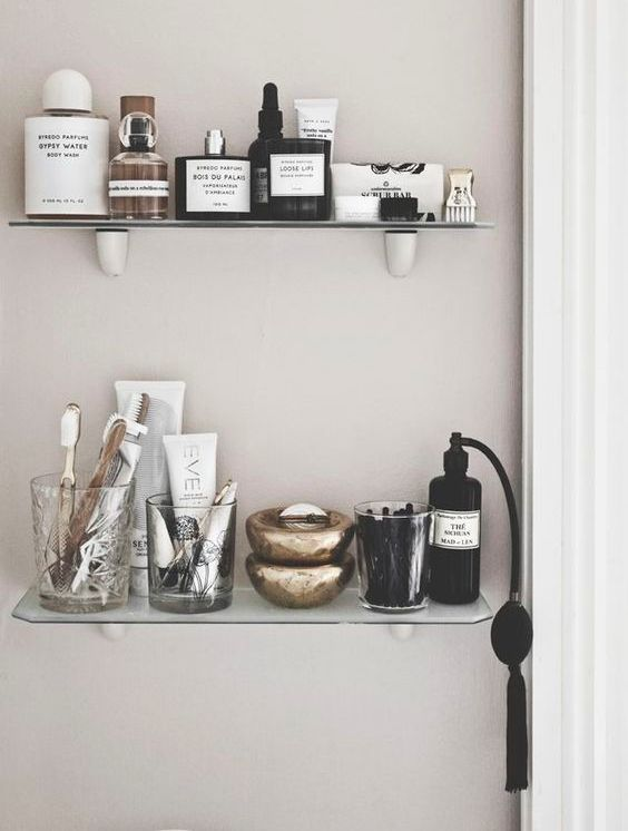 small open bathroom shelves of glass are a very elegant choice besides they won't take much space