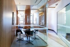 16 a meeting room inside a home with curved glazed walls