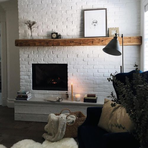 accent the fireplace with an exposed white brick wall, a faux or real one