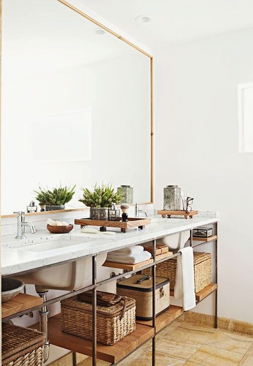 an industrial double vanity features open shelves inside
