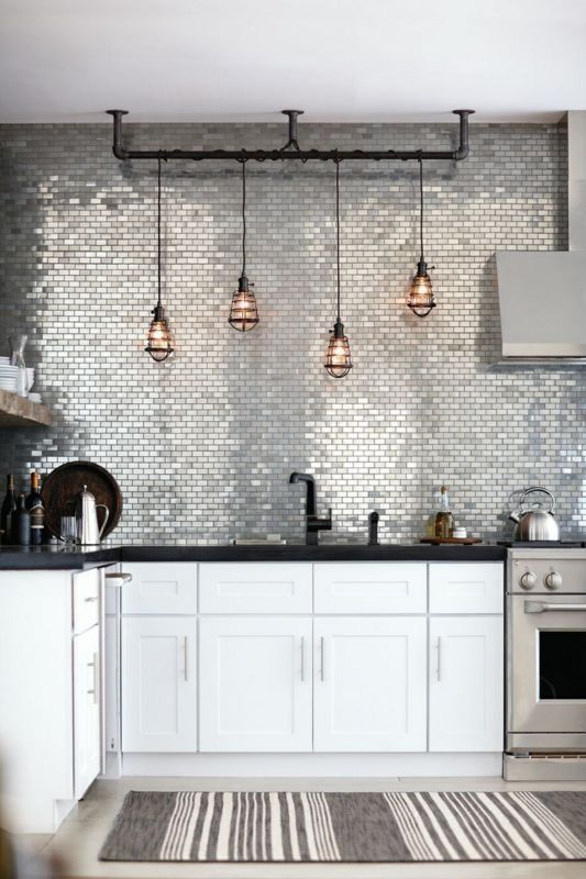 glossy silver tiles covering the whole wall are just jaw-dropping