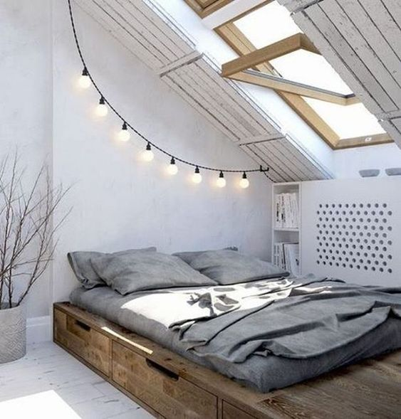 some string lights add light to this attic space