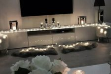 17 highlight your TV zone with string lights and maybe candles, this is a great way to accent