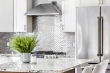 17 small scale silver tiles in a white kitchen for a bold and shiny touch