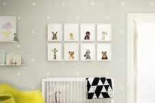 18 a cheerful dove grey and yellow nursery with animal pics, a polka dot wall and a fun chandelier