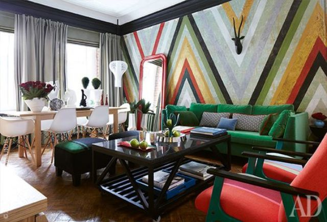 accent made with a colorful stripe geometric wall and bold furniture