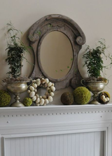 an egg wreath, moss balls and potted greenery plus a vintage mirror for a vintage space