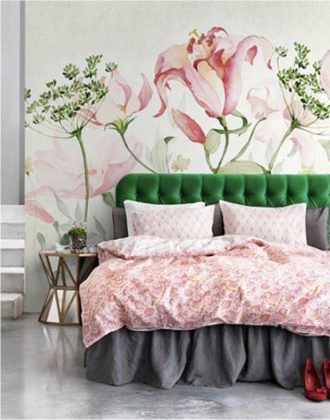 beautiful large blooms and greenery painted on the wall, a matching green bed and pink bedding