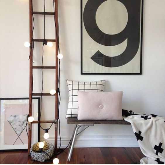cover the ladder with string lights to make the space cute and use it for storage