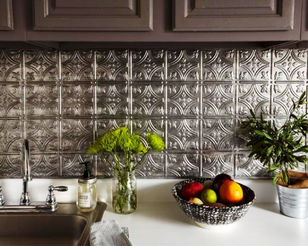 dark cabinets with silver metal hammered tiles that bring an Eastern feel to the space