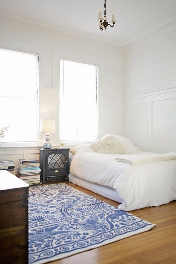 negative space here helps the bedroom look more airy and relaxing