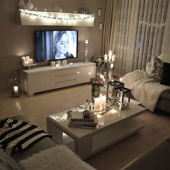 String Lights On A Shelf Over The TV Make An Accent On This Zone And Candles