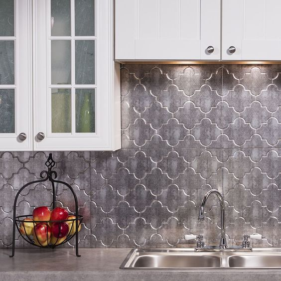 Moroccan-inspired silver tiles make the neutral kitchen much more special