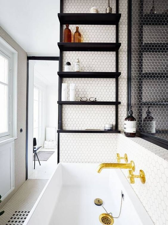 a black open shelving unit suspended over the sink