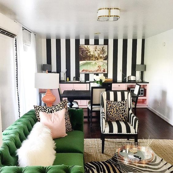 a grass green Chesterfield sofa adds a colorful statement to the home office