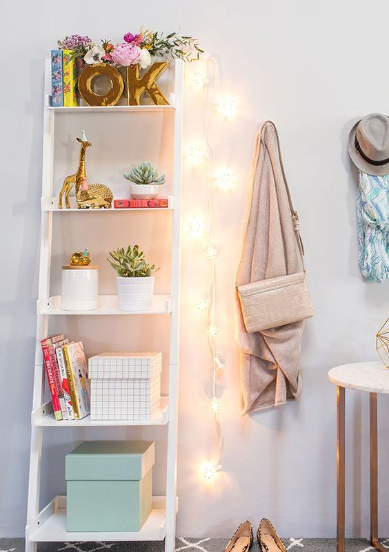 a string of lights hanging on the wall will substitute a lamp