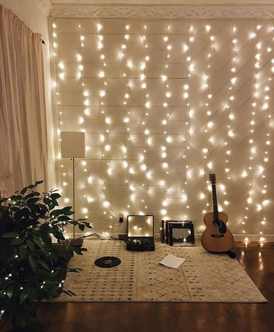 A Hobby Nook In The Living Room Is Accented With Whole String Lights Wall