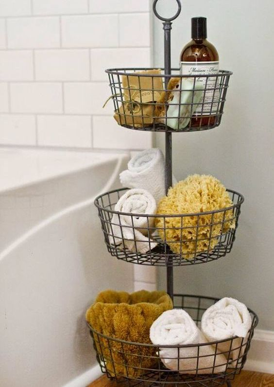 a tiered metal basket organizer for a bathroom