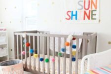 20 add touches of color to your gender neutral nursery with bright upholstery, a colorful pompom garland and a sign
