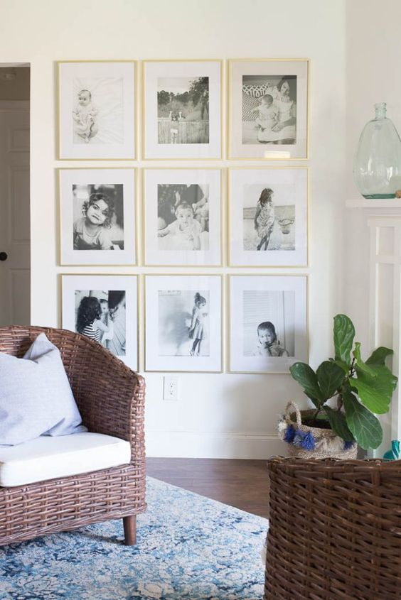 an elegant gallery wall in gold frames with personal family photos is ideal for any room
