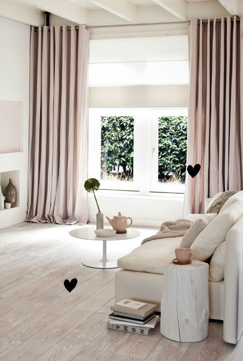 blush curtains add color to this neutral space and make it softer and more girlish