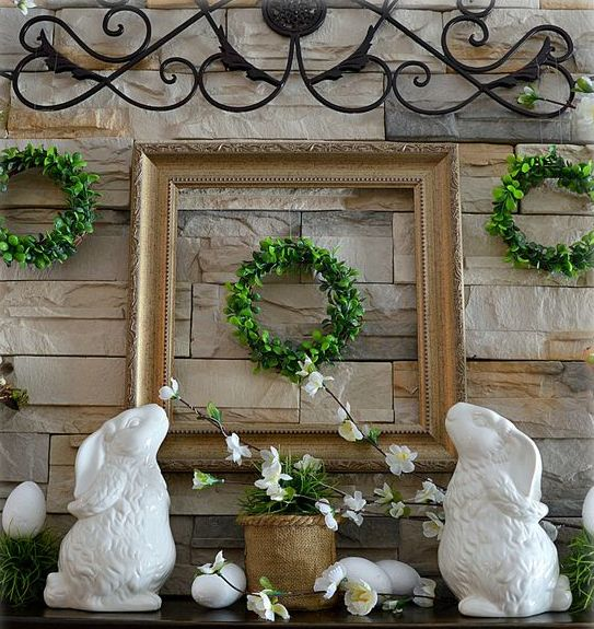 little boxwood wreaths, potted greenery, faux eggs and porcelain bunnies for a traditional mantel