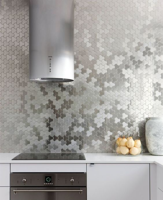 neutral kitchen with stainless steel appliances and silver geometric tiles