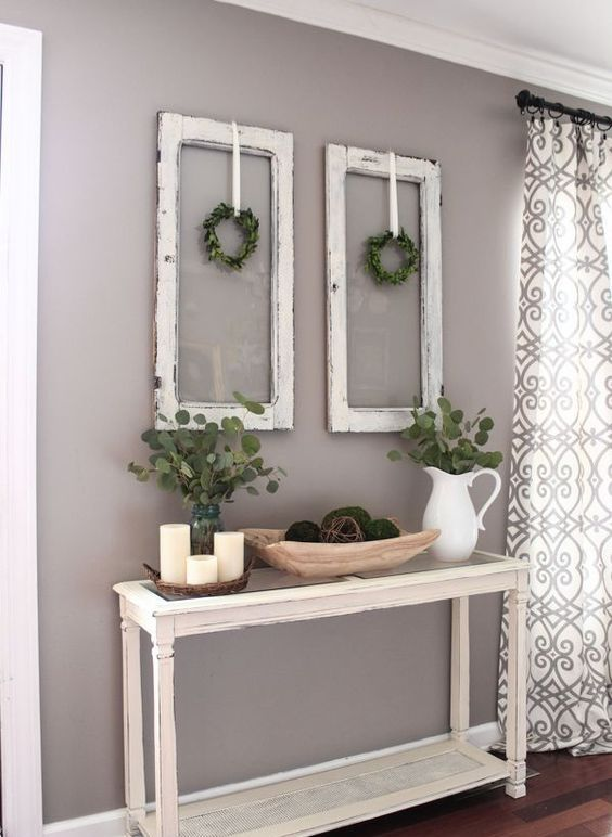 shabby chic windows with boxwood wreaths, fresh eucalyptus in jugs and moss balls in a wooden bowl
