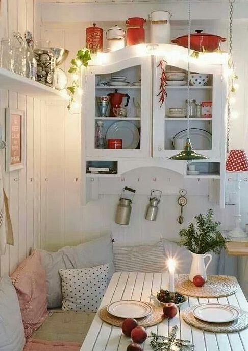 string lights over the cabinet are great for holiday and all-year-round decor