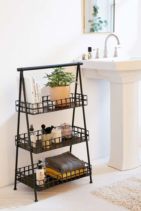 a three-tiered metal storage piece next to the sink is a comfy idea instead of a vanity