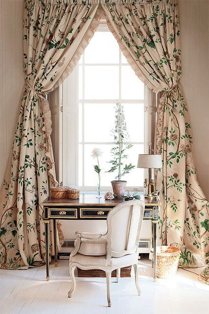 botanical print curtains with ruffles make this refined home office more interesting