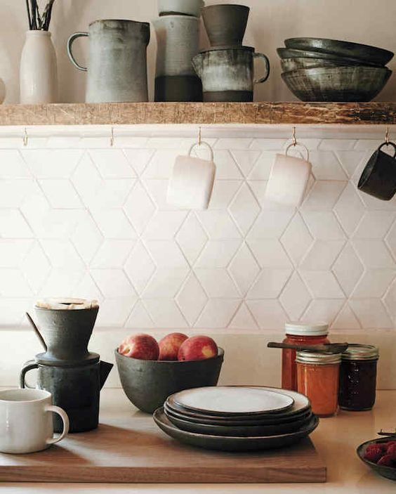 eye-catchy geometric tiles on the kitchen backsplash look chic and interesting